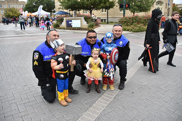 Officers Damian Guerrero, Adrian Guzman and Randy Patton with little superheroes at Scare on the Square